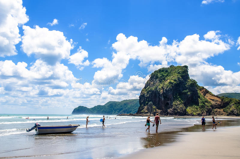 Piha beach,which is located at the West Coast in Auckland,New Zealand. Auckland,New Zealand - March 3,2016 : People can seen exploring and relaxing around Piha stock photos