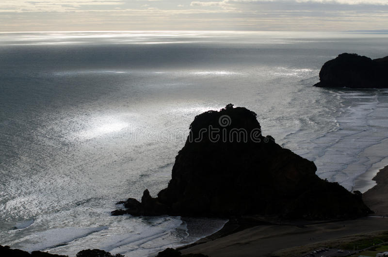 Piha - New Zealand. Aerial view of the Lion rock in Piha, New Zealand royalty free stock image