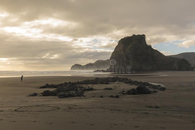 Piha, West Coast winter. Piha beach on Auckland`s wild west coast with its iconic Lion Rock royalty free stock photos