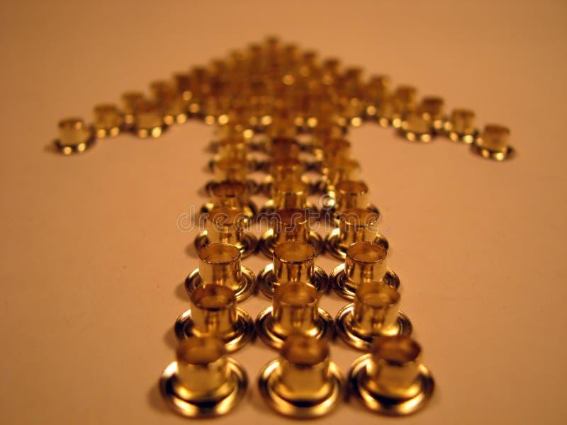 Pijl van gouden klinknagels stock foto