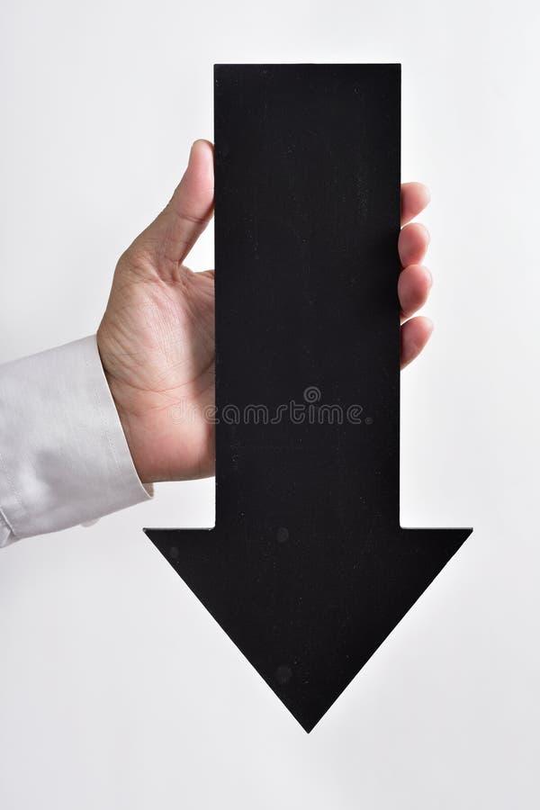 Pijl-vormig uithangbord die naar beneden richten stock foto's