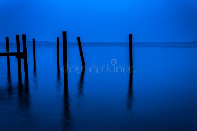 Pijler opstapelen zich gezien tijdens schemering in de Chesapeake Baai, Havre D royalty-vrije stock foto's