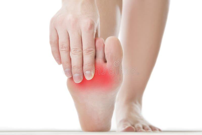 Pijn in de vrouwelijke voet royalty-vrije stock foto