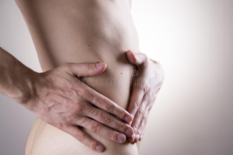 Pijn in een man lichaam Aanval van blindedarmontsteking royalty-vrije stock foto's