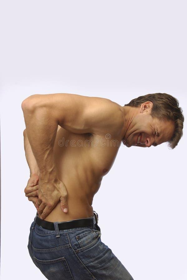 Pijnlijke lagere rugpijn stock foto's