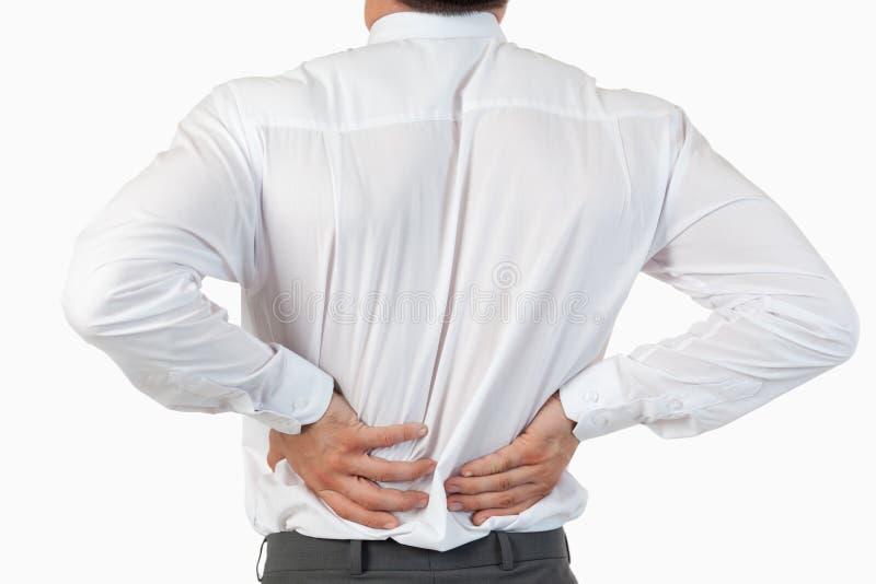 Pijnlijke rug van een zakenman stock afbeeldingen