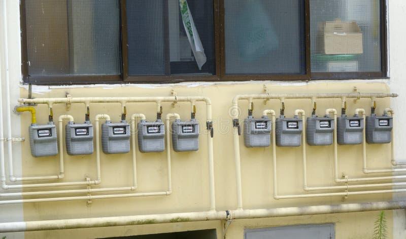 Pijpen en gas-meter stock fotografie