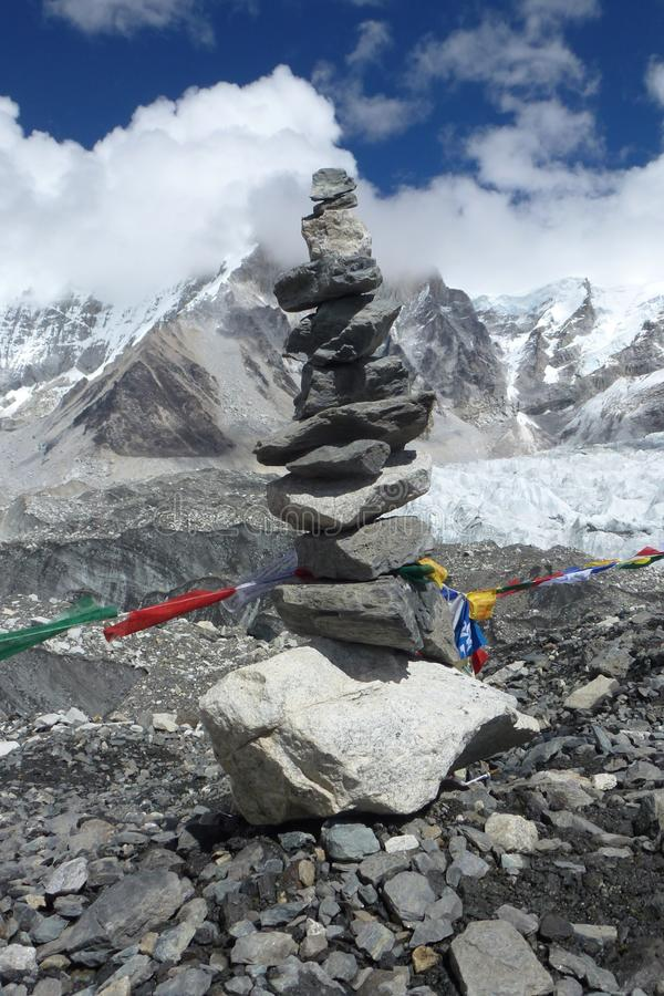 Pika (piled stones) with prayer flags at the EBC, Everest Base Camp trek, Nepal. Detail of a Pika (piled stones) with prayer flags at the EBC, Everest Base Camp stock image