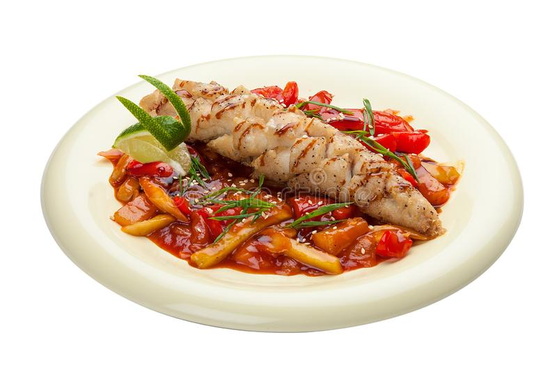 Pike perch with vegetables in sweet and sour sauce. Asian cuisine stock photography