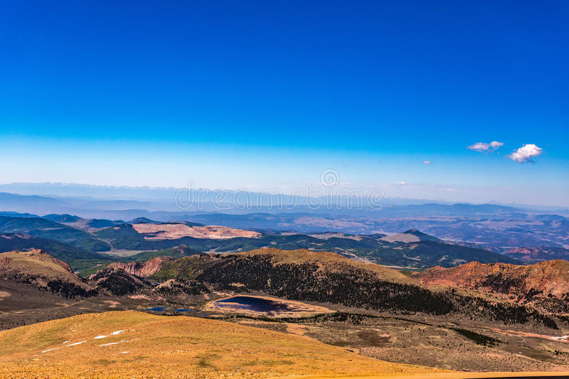 Pikes Peak Colorado. Pikes Peak is the highest summit of the southern Front Range of the Rocky Mountains. The ultra-prominent fourteener is located in Pike stock photo