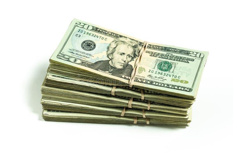 Pila de billetes de dólar de la moneda veinte de los E.E.U.U. imagen de archivo