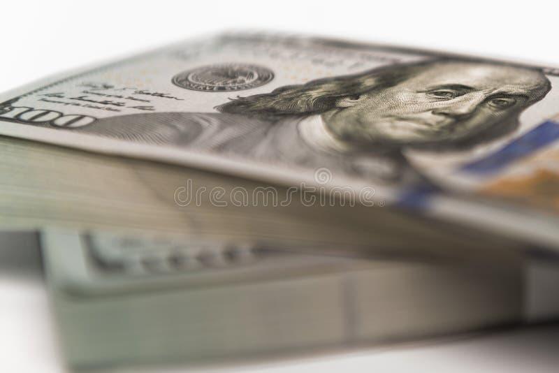 Pila de billetes de banco del efectivo del dinero en dólares americanos imagen de archivo libre de regalías
