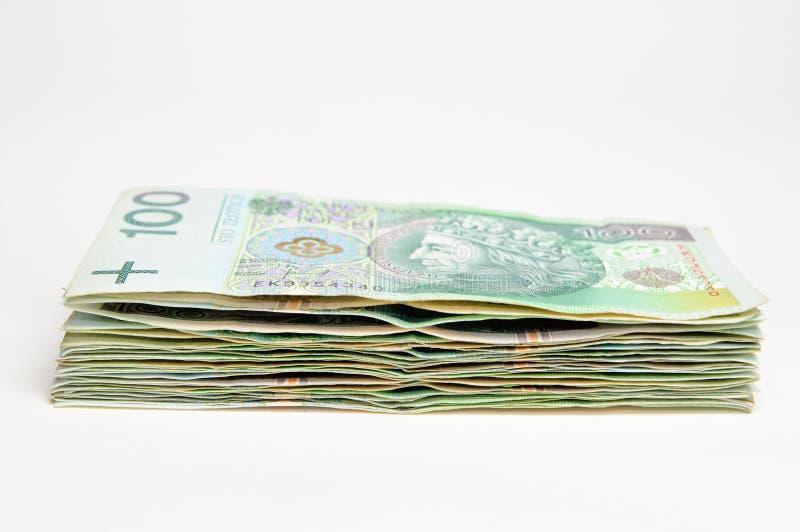 Pila de billetes de banco del pln del pulimento 100 aislados fotografía de archivo libre de regalías