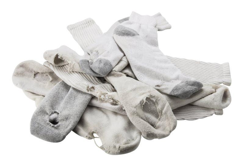 Pila de calcetines viejos con los agujeros fotos de archivo libres de regalías