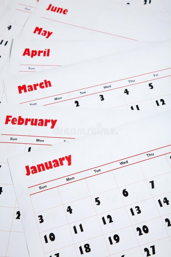 Pila de calendarios mensuales fotografía de archivo libre de regalías