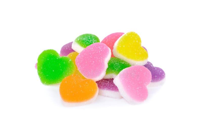 Pila de caramelo colorido de la jalea en el fondo blanco foto de archivo libre de regalías
