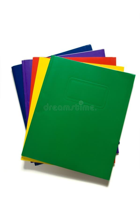 Pila de carpetas de la escuela imagen de archivo