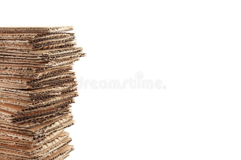 Pila de cartulina en el fondo blanco imagen de archivo libre de regalías