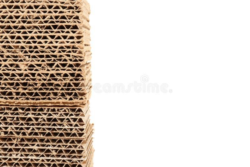 Pila de cartulina en el fondo blanco imagen de archivo
