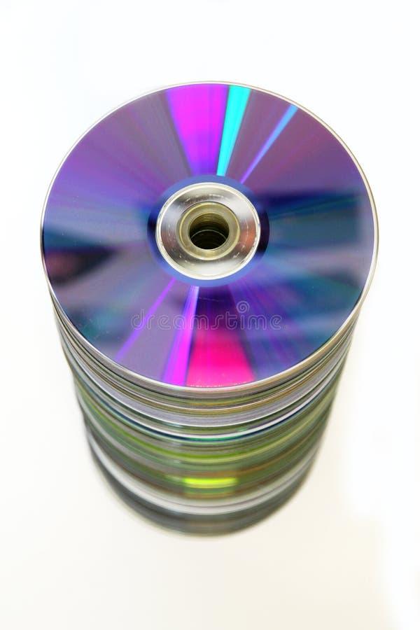 Pila de Cdes y de DVDs imagen de archivo libre de regalías