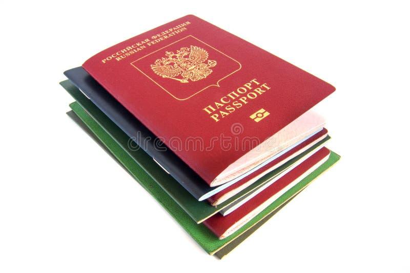 Pila de documentos con el pasaporte fotografía de archivo libre de regalías