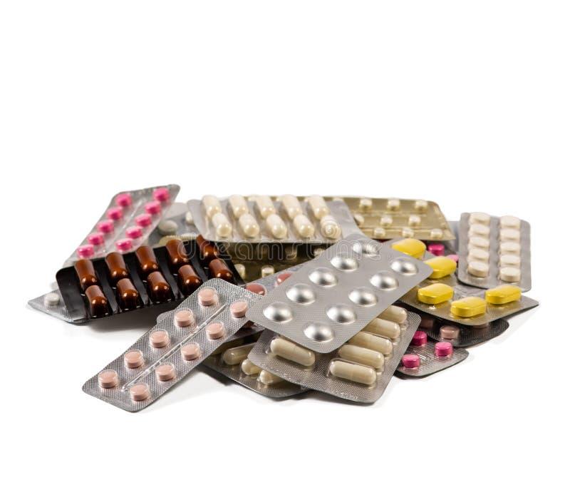 Pila de diversos paquetes de ampolla con las píldoras fotos de archivo