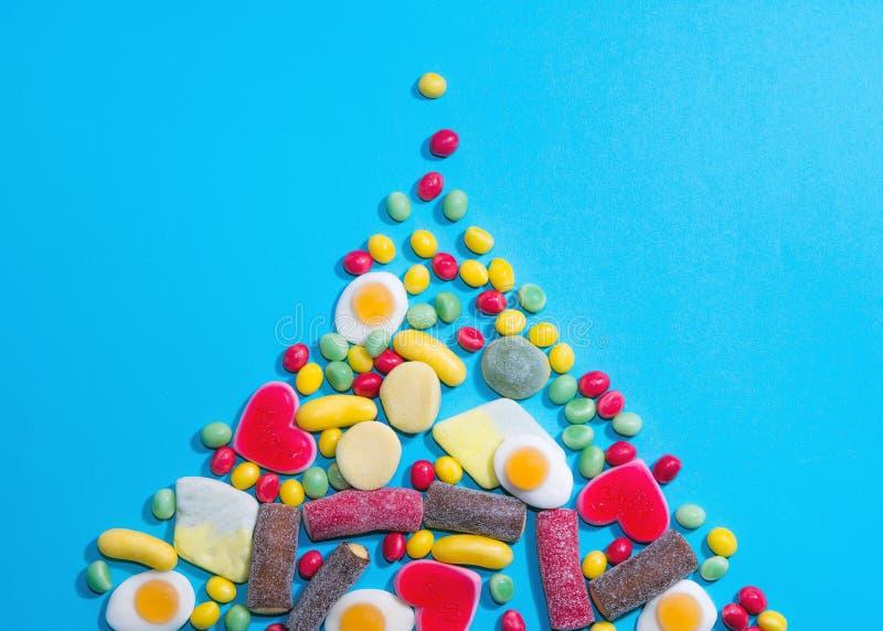 Pila de fondo de masticación colorido delicioso de los caramelos Dulces coloridos fotografía de archivo libre de regalías