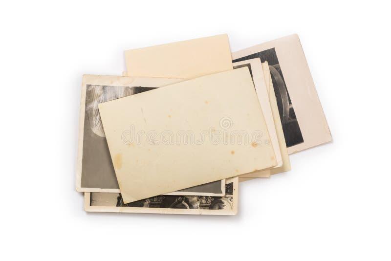 Pila de fotos viejas con el camino de recortes para el interior imagen de archivo