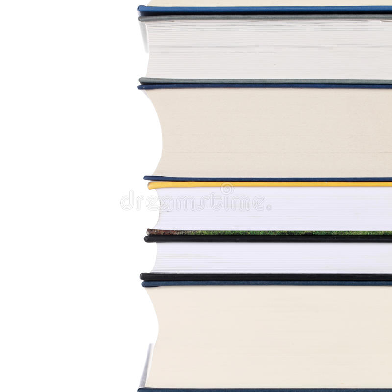 Pila de libros, aislada en blanco fotos de archivo