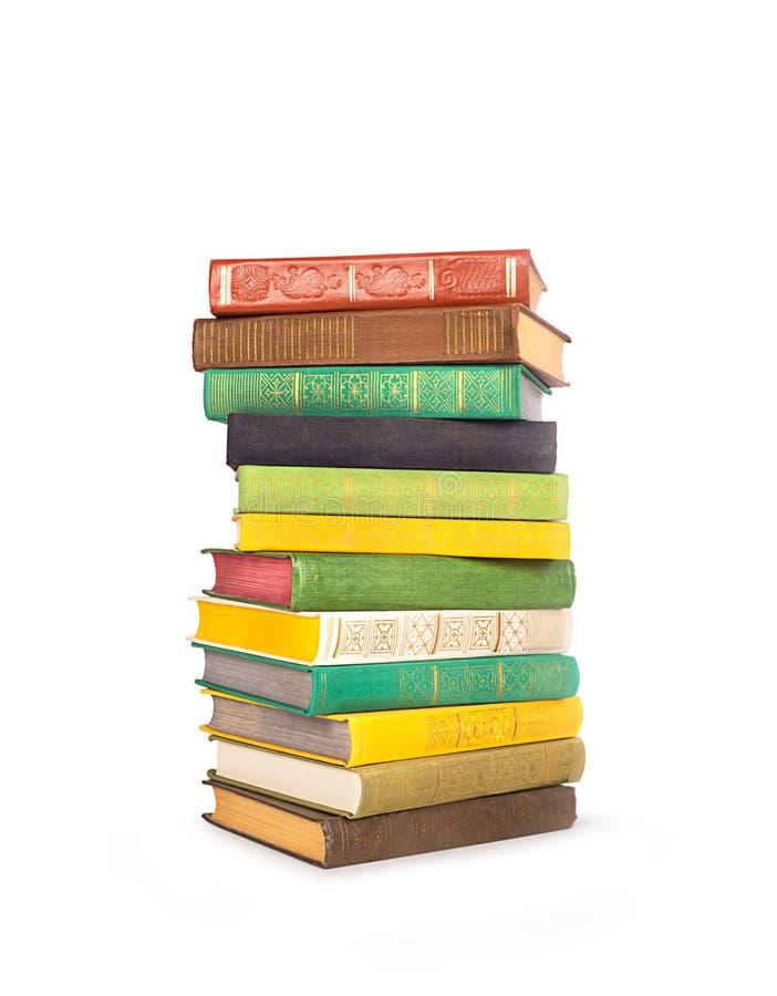 Pila de libros aislados en blanco imágenes de archivo libres de regalías