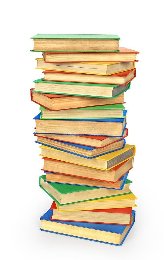 Pila de libros coloreados aislados foto de archivo