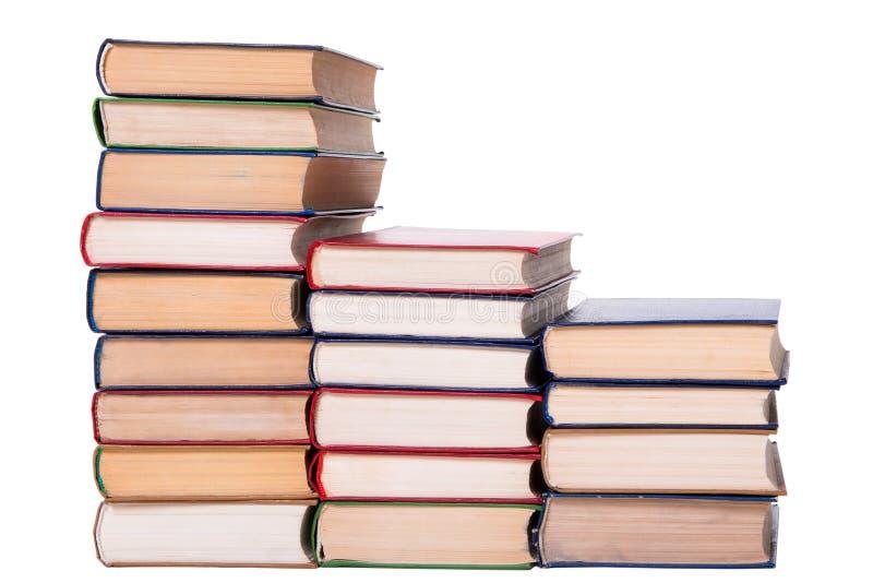 Pila de libros multicolora aislada en el fondo blanco. imagenes de archivo