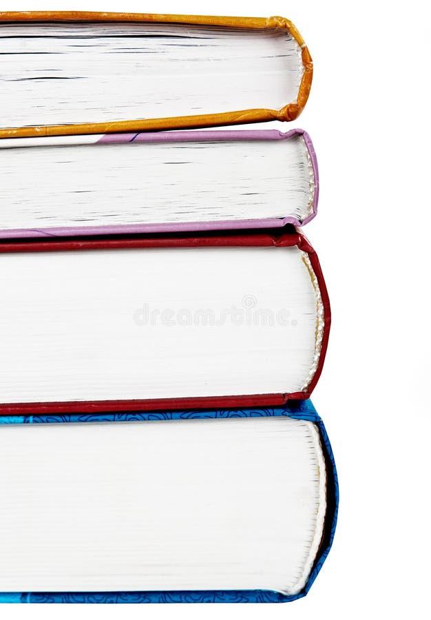 Pila de libros verdaderos coloridos fotos de archivo