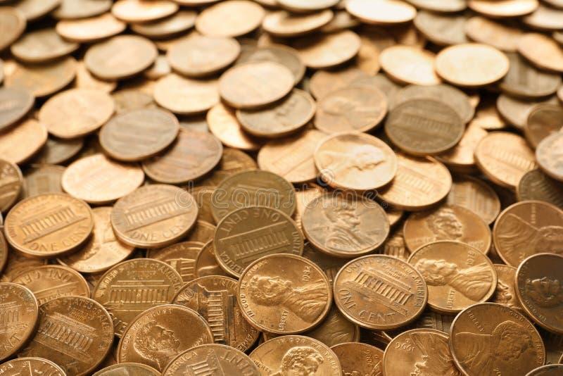 Pila de los E.E.U.U. brillantes monedas de un centavo fotos de archivo libres de regalías