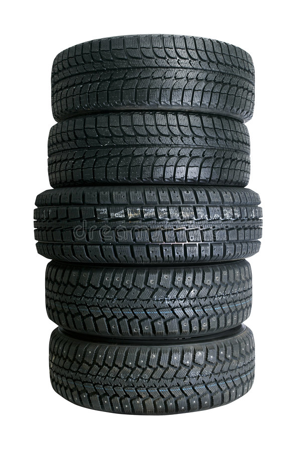 Pila de nuevos neumáticos imagenes de archivo