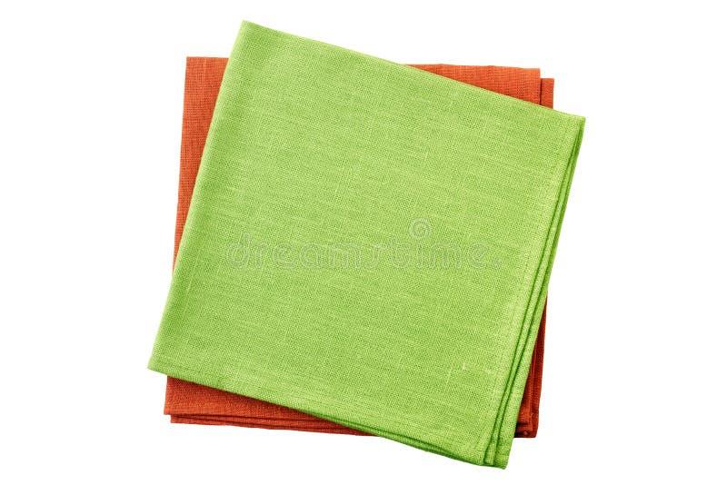 Pila de pálido - servilletas dobladas verdes y rojas en blanco imágenes de archivo libres de regalías