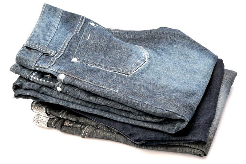 Pila de pantalones vaqueros imagen de archivo libre de regalías
