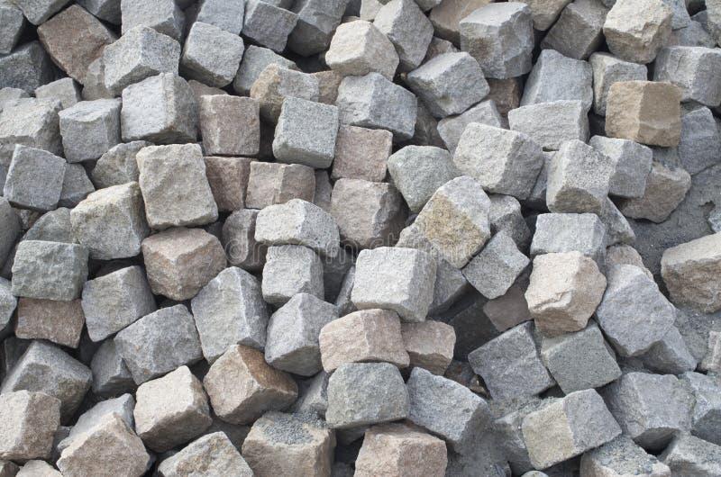 Pila de primer de muchas pavimentadoras del granito foto de archivo