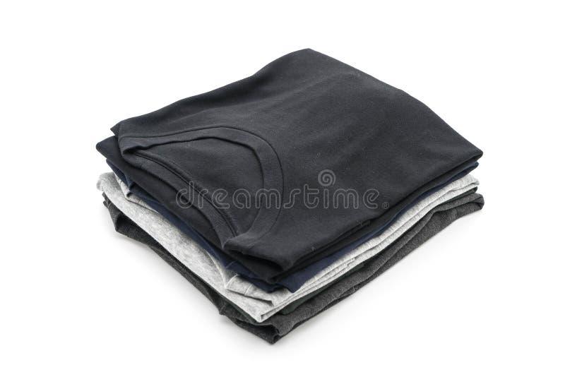 Pila de ropa en blanco foto de archivo