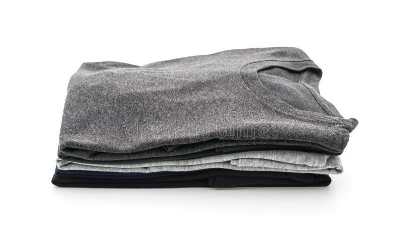 Pila de ropa en blanco imagen de archivo libre de regalías