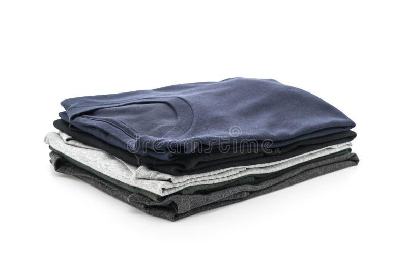 Pila de ropa en blanco imagenes de archivo