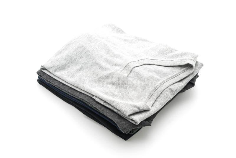 Pila de ropa en blanco fotografía de archivo libre de regalías