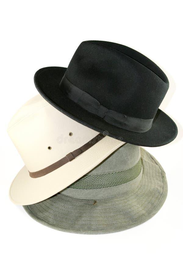 Pila de sombreros del Mens foto de archivo