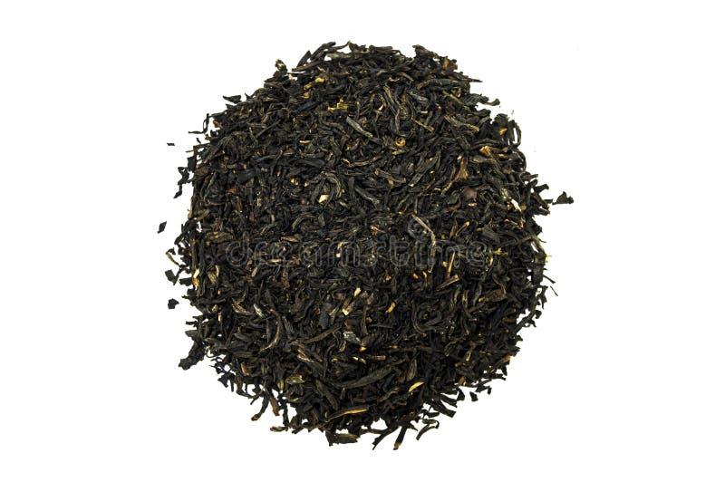 Pila de té aislada en el fondo blanco imagenes de archivo