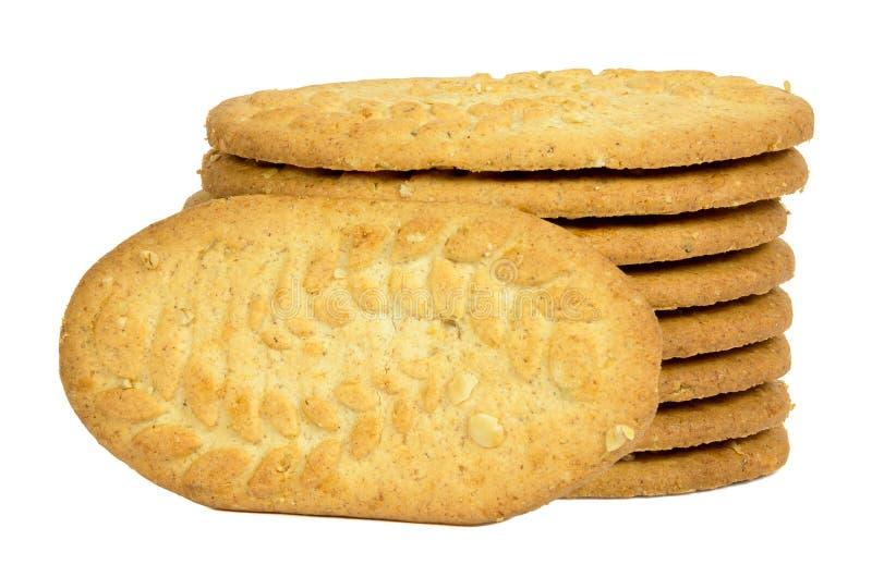 Pila di biscotti su fondo bianco immagini stock libere da diritti