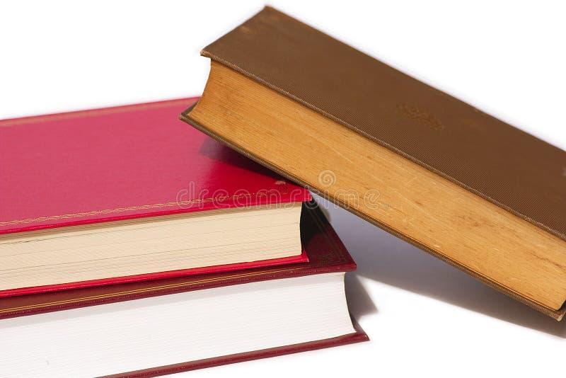 Pila di libri caduti immagini stock