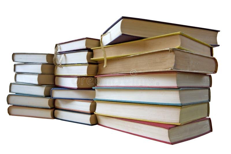 Pila di libri dell'annata, isolata immagine stock