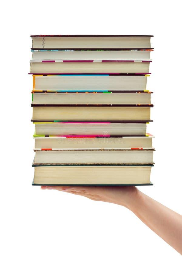 Pila di libri a disposizione immagine stock
