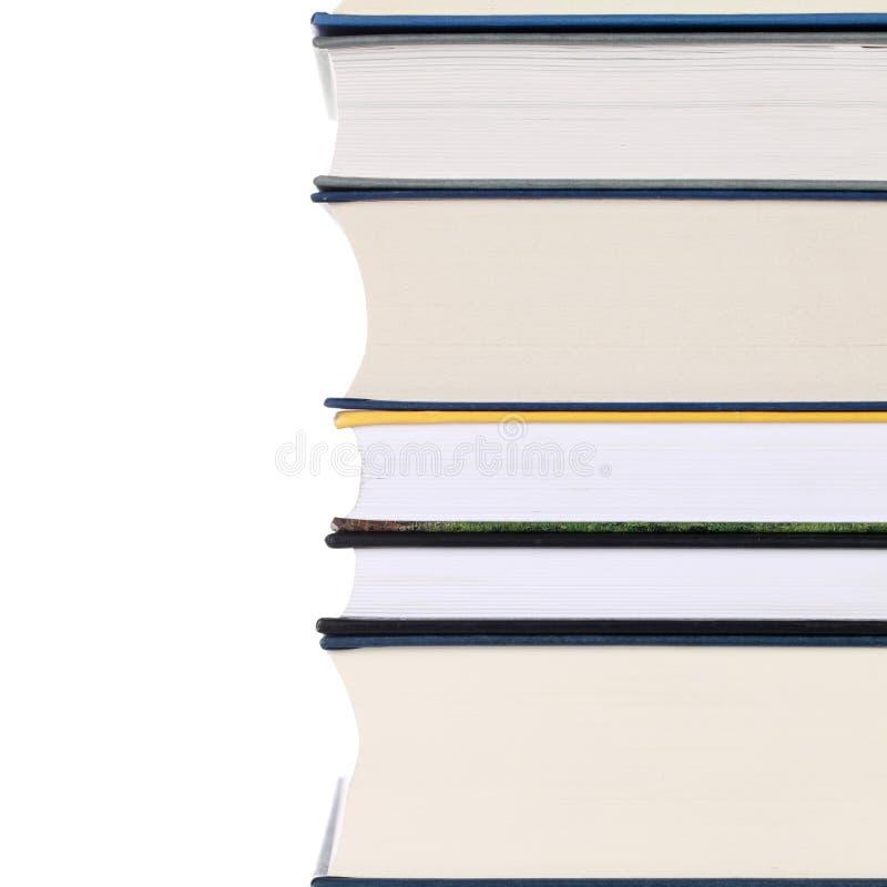 Pila di libri, isolata su bianco fotografie stock