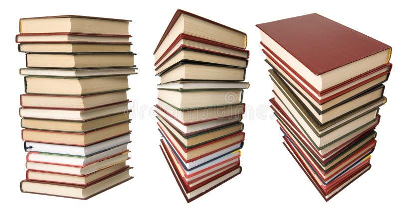 Pila di libri isolati sul bianco immagini stock libere da diritti